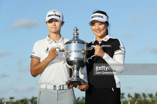 CoRolex Players of the Year Sung Hyun Park of Korea and So Yeon Ryu of Korea pose with the Rolex Player of the Year trophy after the final round of...