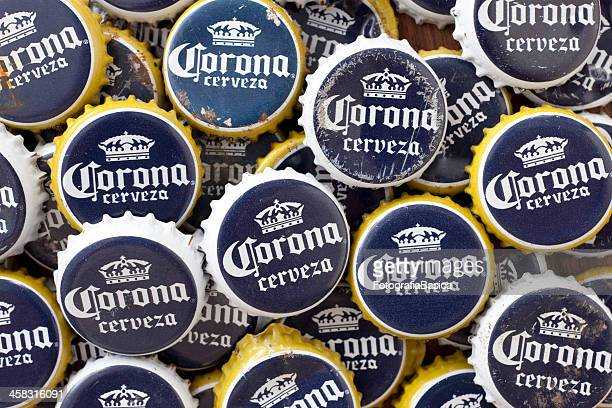 corona beer crown caps - corona beer stock pictures, royalty-free photos & images