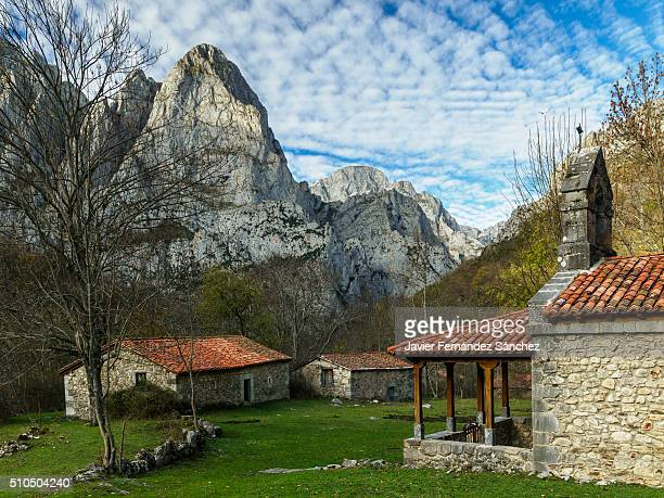 Corona hermitage with cottages and mountain landscape of the Picos de Europa. Spain