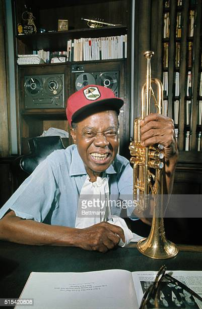 World renowned jazz trumpeter Louis Satchmo Armstrong who celebrated his 70th birthday July 4 1970 displays his famous trumpet in the den of his home