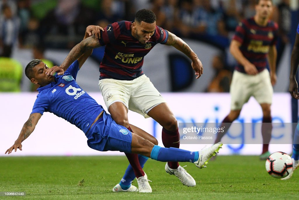 Corona of FC Porto competes for the ball with Jamaal Lascelles of Newcastle during the pre-season friendly match between FC Porto and Newcastle at Estádio do Drago on July 28, 2018 in Porto, Portugal.