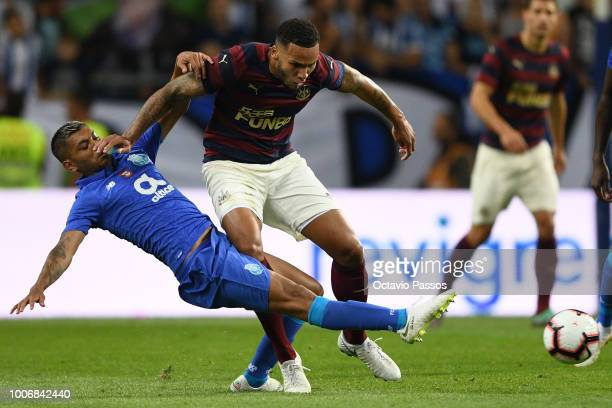 Corona of FC Porto competes for the ball with Jamaal Lascelles of Newcastle during the preseason friendly match between FC Porto and Newcastle at...