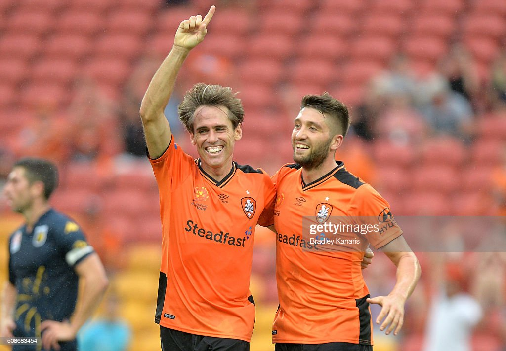 Corona (L) of the Roar celebrates scoring a goal during the round 18 A-League match between the Brisbane Roar and Central Coast Mariners at Suncorp Stadium on February 6, 2016 in Brisbane, Australia.