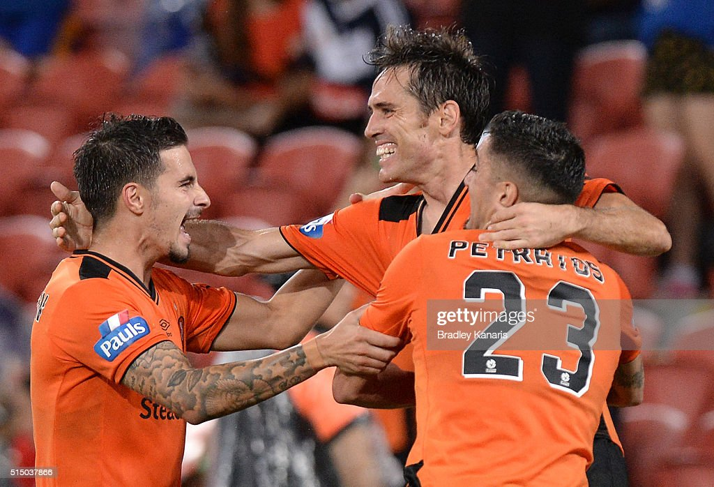 Corona of the Roar celebrates with team mates after scoring a goal during the round 23 A-League match between the Brisbane Roar and Melbourne Victory at Suncorp Stadium on March 12, 2016 in Brisbane, Australia.
