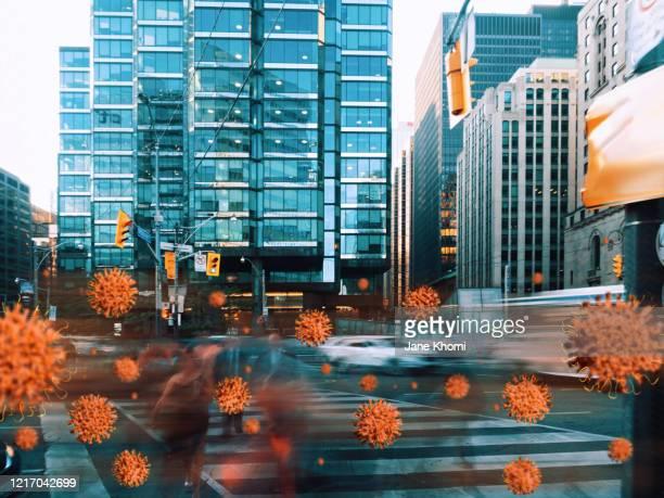 corona virus between people in the street - untar fotografías e imágenes de stock