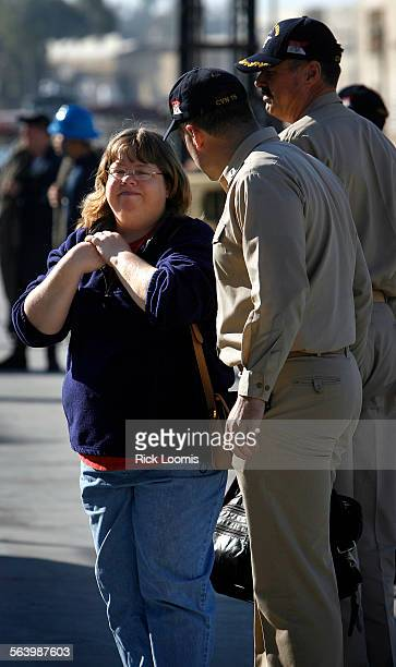 Coronado Ca – Trudy Lafield watches as her daughter Laura Montero is loaded into a waiting ambulance after being offloaded from the USS Reagan where...