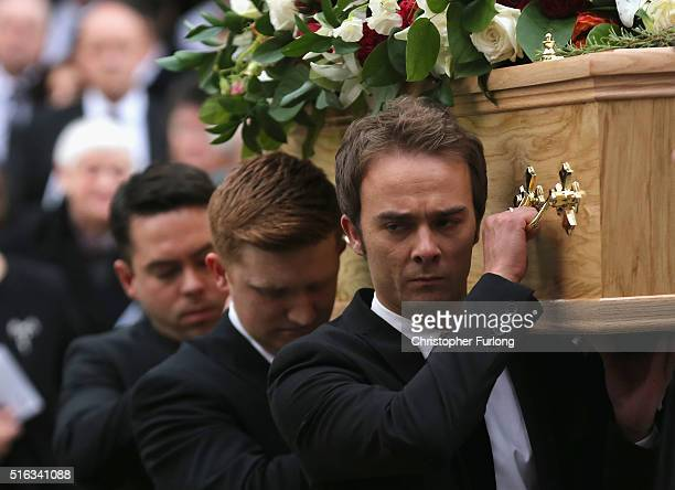 Coronation St cast members Bruno Langley Sam Aston and Jack P Shepherd carry the coffin of Coronation Street scriptwriter Tony Warren after his...