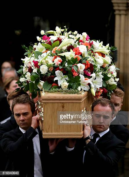Coronation St cast members Jack P Shepherd and Alan Halsall carry the coffin of Coronation Street scriptwriter Tony Warren after his funeral service...