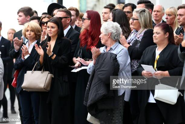 Coronation Street actor Helen Worth applauds with fellow mourners at the end of the funeral of Martyn Hett at Stockport Town Hall on June 30, 2017 in...