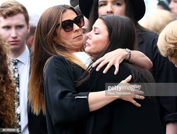 Coronation Street actor Kym Marsh hugs a fellow mourner at the end of the funeral of Martyn Hett at Stockport Town Hall on June 30 2017 in Stockport...