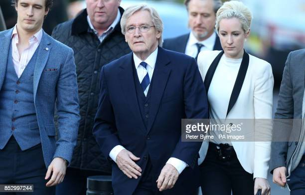 Coronation Street actor William Roache arrives at Preston Crown Court with son James and daughter Verity where he denies two counts of raping a...