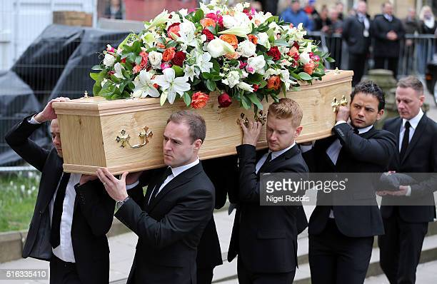 Coronation Street actors carry the coffin for the funeral of Coronation Street scriptwriter Tony Warren at Manchester Cathedral on March 18 2016 in...