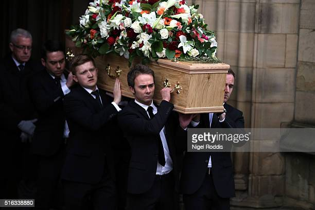 Coronation Street actors Jack Shepherd and Sam Aston carry the coffin after the funeral of Coronation Street scriptwriter Tony Warren at Manchester...