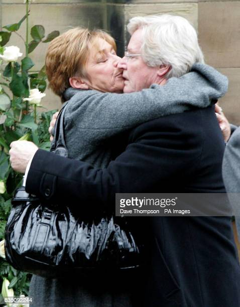 Coronation Street actress Anne Kirkbride kisses on screen husband Bill Roache after a memorial service for his wife Sara, at St Bartholomew's Church,...