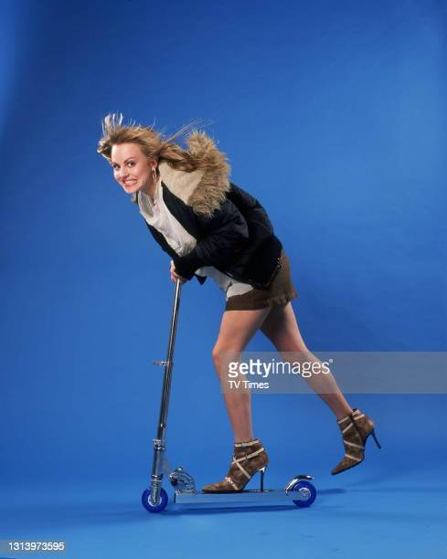 Coronation Street actress Tina O'Brien who plays Sarah-Louise Tilsley riding a scooter, circa 2003.