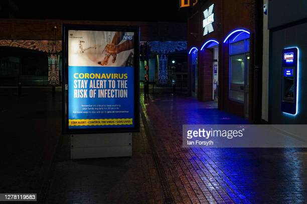 A coronavirus advice sign illuminates an empty town centre street on October 02 2020 in Middlesbrough England The mayor of Middlesbrough Andy Preston...