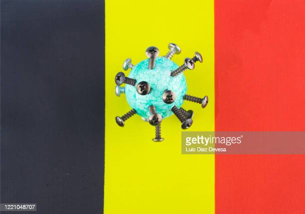 coronavirus covid-19 and belgium flag - democracy stock pictures, royalty-free photos & images