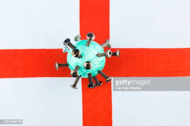 coronavirus covid-19 and england flag - antiseptic wipe stock pictures, royalty-free photos & images