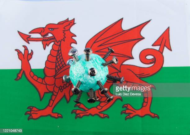 coronavirus covid-19 and welsh flag - welsh flag stock pictures, royalty-free photos & images
