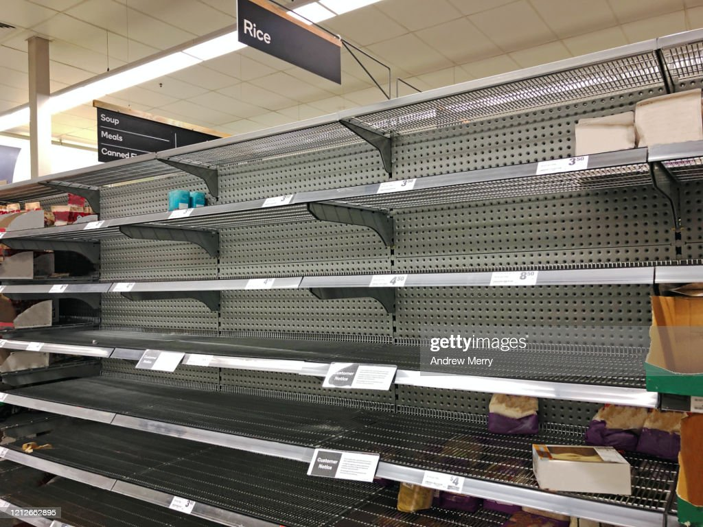 Coronavirus, COVID-19 pandemic, empty supermarket shelves from panic buying : Stock Photo