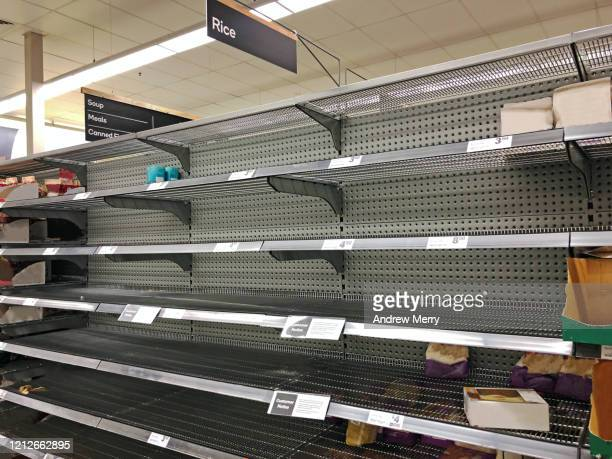coronavirus, covid-19 pandemic, empty supermarket shelves from panic buying - no people stock pictures, royalty-free photos & images