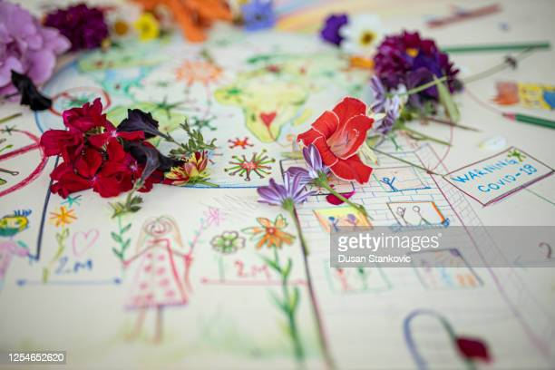 coronavirus drawing and fresh flowers - dusan stankovic stock pictures, royalty-free photos & images