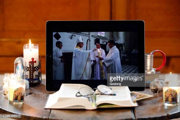 Coronavirus epidemic . Altar at home. Holy Week. Broadcast of the Easter vigil on Youtube. France.