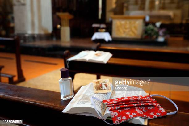 Coronavirus epidemic . Bible. Alternative mask and hydroalcoholic gel in a church. Social distancing. Sallanches. France.