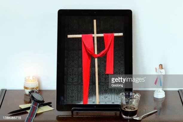 Coronavirus epidemic . Catholic mass on smartphone. Easter. France.