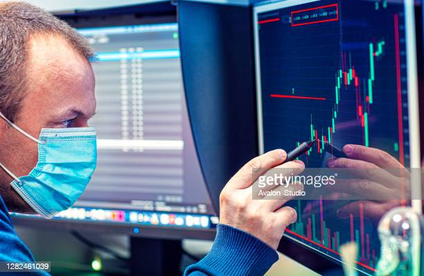 coronavirus global financial problem - stock trader stock pictures, royalty-free photos & images