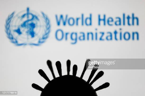 Coronavirus model is seen with World Health Organization logo in the background in this illustration photo taken in Poland on June 5, 2020.