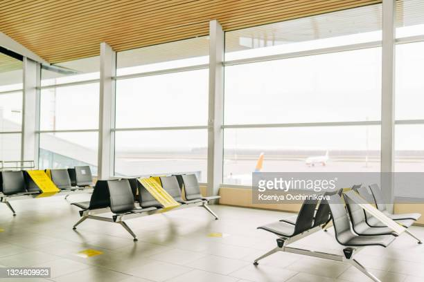 coronavirus outbreak, empty check-in desks at the airport terminal due to pandemic of coronavirus and airlines suspended flights. - aeroplane stock pictures, royalty-free photos & images