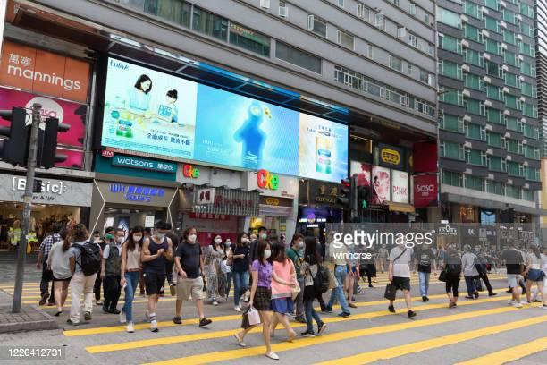 coronavirus outbreak in hong kong - tsim sha tsui stock pictures, royalty-free photos & images
