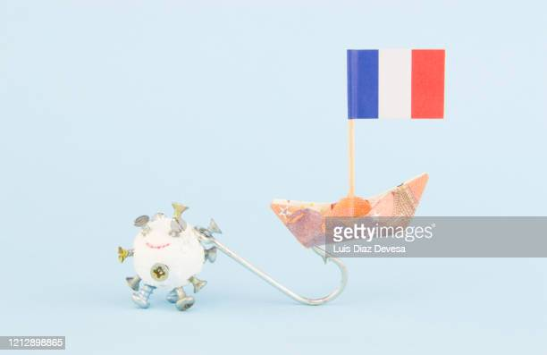 (covid-19) coronavirus pandemic  hurt the france economy - france stock pictures, royalty-free photos & images