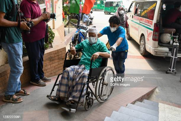 Coronavirus patient in a wheelchair arrives at Mugda Medical College Hospital for treatment. Bangladesh extends nationwide lockdown measures until...