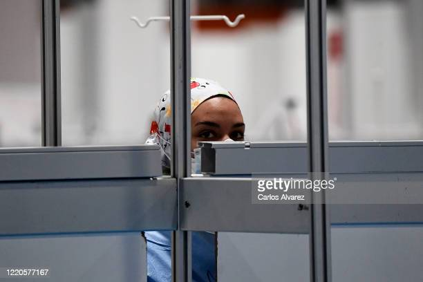 Coronavirus patient is seen at the COVID-19 IFEMA Hospital on April 23, 2020 in Madrid, Spain. Starting last week, some businesses deemed...