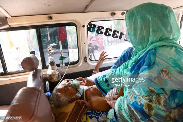 Coronavirus patient seen being taken to Mugda Medical College Hospital with his family member for treatment. Bangladesh extends nationwide lockdown...