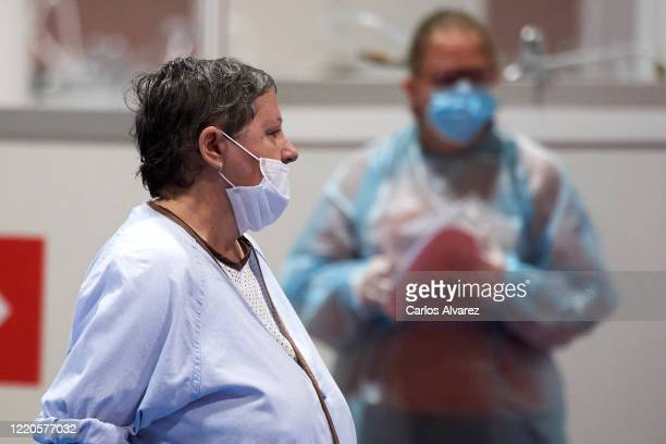 Coronavirus patients ar seen at the COVID-19 IFEMA Hospital on April 23, 2020 in Madrid, Spain. Starting last week, some businesses deemed...