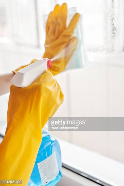 coronavirus prevention - wiping surfaces, windows, cleaning home - alertness stock pictures, royalty-free photos & images