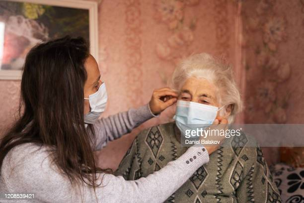 coronavirus protection. woman wearing mask to avoid infectious diseases. - covid 19 stock pictures, royalty-free photos & images