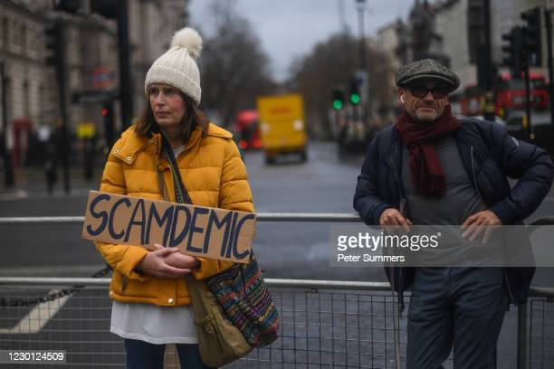 Coronavirus protesters are seen outside the Houses of Parliament, as talk continues of London entering into 'Tier 3' of the pandemic-control system,...