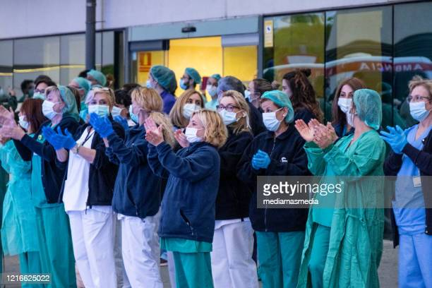 coronavirus reactions in valencia, tribute to all health workers in valencia, spain - nurse stock pictures, royalty-free photos & images