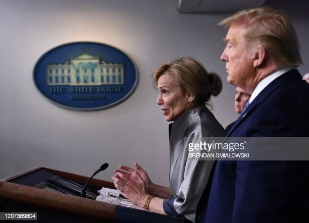 Coronavirus Response Coordinator Dr Deborah Birx speaks as US President Donald Trump looks on during a press briefing at the White House in...