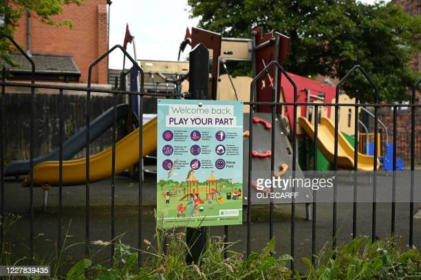 A coronavirus safety guideline is attached to the gates of a playground in Rochdale greater Manchester northwest England on July 30 2020 Rochdale...