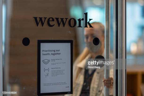 Coronavirus safety sign on a door at a WeWork co-working office space in the Waterloo district in London, U.K. On Monday, Aug. 2, 2021. A survey this...