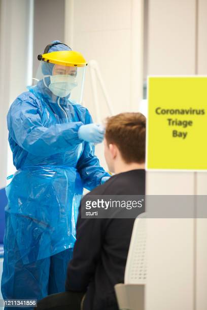 coronavirus screening at medical centre - screening stock pictures, royalty-free photos & images