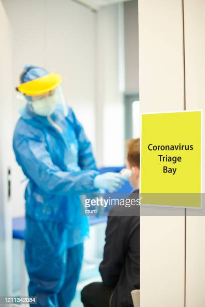 coronavirus screening at medical centre - patient stock pictures, royalty-free photos & images