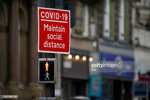 coronavirus sign ecouraging social distancing - department of health stock pictures, royalty-free photos & images