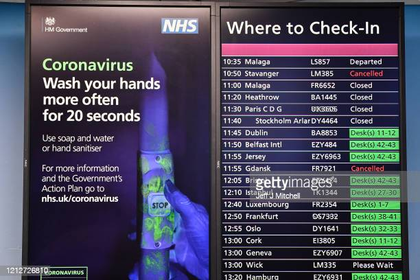 Coronavirus signs are seen at Edinburgh Airport on March 16 2020 in EdinburghScotlandTravel restrictions and a slump in demand for flights as a...