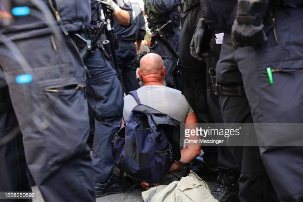 Coronavirus skeptics and right-wing extremists clash with police during a march in protest against coronavirus-related restrictions and government...